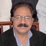Mazhar I. Khan smiling